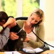 Blonde woman trying to work in office despite her child — Stock Video #23496813