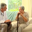 Doctor consulting with a mature female patient — Stock Video #23496921