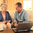 Mature couple using a credit card — Stock Video