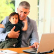 Businessman struggling with baby and laptop — Stock Video