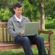 Young man chatting on his laptop — Stok video