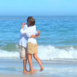 Couple meeting and hugging on a beach — Stock Video