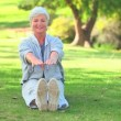 Mature woman doing her stretches — Stock Video #23498005