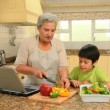 Woman showing her grandson how to cook — Stock Video #23498435