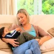 Young mother bottle feeding toddler — Stock Video #23498957