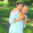 Young girl hugging her mother — Stock Video