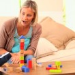 Baby learning to build a tower with blocks — Stock Video