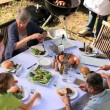 Stock Video: Family Barbecue meal in garden