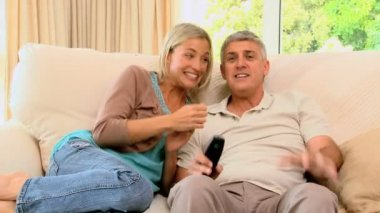 Couple excitedly watching sports on tv — Stock Video