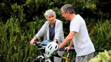 Mature couple with two bikes — Wideo stockowe
