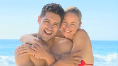 Sweet couple posing on a beach — Stock Video