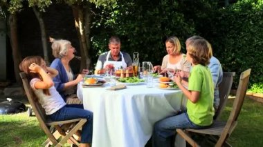 Family barbecue meal in the garden — Stock Video