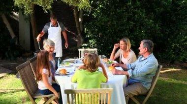 Family Barbecue in garden — Stock Video