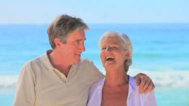 Happy mature couple on a beach — Stock Video