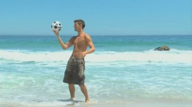 Handsome dark-haired man playing with a soccer ball — Stock Video