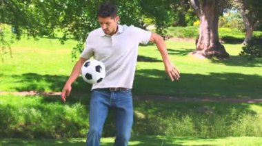 Young man playing with a ball — Stock Video