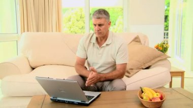 Man seeing disastrous news on his laptop — Stock Video