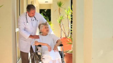 Doctor with wheelchair patient — Stock Video