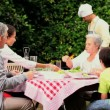 Father cooking at family barbecue — Stock Video #23500151