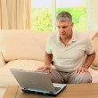 Man delighted with something on laptop — Video Stock
