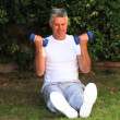 Man exercising his arms using dumbbells — Stock Video
