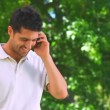 Young man talking on the phone — Stock Video