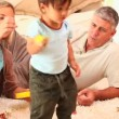 Parents playing with their little son — Stock Video #23501467