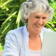 Mature woman working on her laptop — Stock Video #23501709