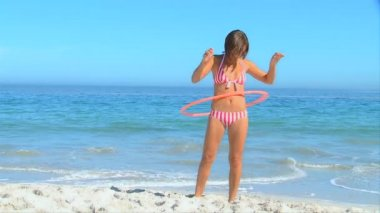Attractive woman playing with a hoop — Stock Video
