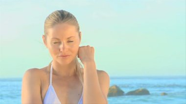Attractive blonde woman on a beach — Stock Video
