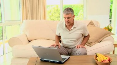 Man delighted with something on laptop — Stock Video