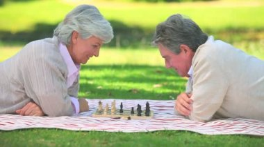 Mature couple playing chess — Stok video