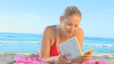 Attractive blond girl on a beach — Stock Video