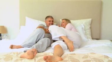 Young couple having fun on bed — Stock Video