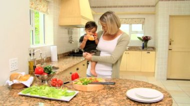 Baby helping mother in the kitchen — Stock Video