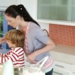 Mother cooking with her Son — Stock Video #23636001