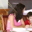 Stock Video: Parents interested in their sons homework
