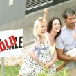 Stock Video: Young family in front of their new house