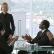 Businesswoman explaining business results to her team — Stock Video