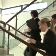 Stock Video: Business Discussion on Stairs