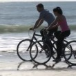 Couple on bikes — Stock Video #23644817