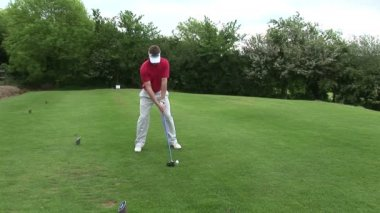A man Teeing off in Golf — Stock Video