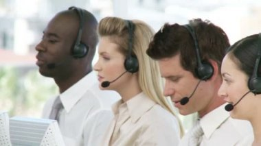Business team with headphones one woman smiling — Stock Video