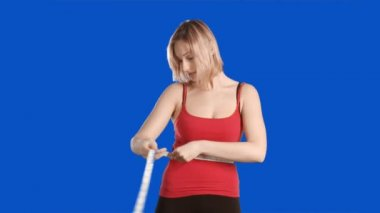 Blue screen footage of a woman working out — Stock Video
