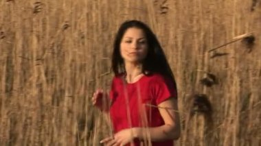 Woman in Reeds — Stock Video