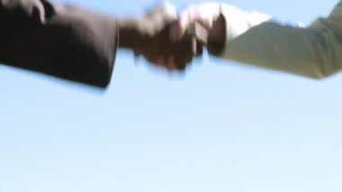 Two businesspeople shaking hands - multi cultural — Stock Video