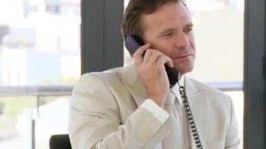 The ultimate businessman on the phone — Stock Video