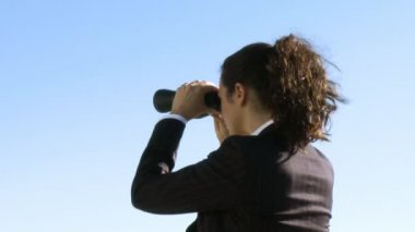 Businesswoman with a binoculars — Stock Video