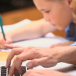 Little girl writing on notebook — Stock Video #23690155