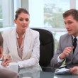 Stock Video: Businesswoman talking with managers